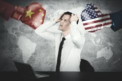 Caucasian businessman looks depressed with trade war royalty free stock images