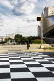 Checker board ground in the road at the Nascar Hall of Fame in Charlotte North Carolina. A picture of the checker board ground in the road at the Nascar Hall of stock photos