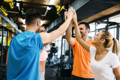 Picture of cheerful fitness team in gym. Picture of young cheerful fitness team in gym Royalty Free Stock Photo