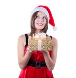 Picture of cheerful santa helper girl with gift Royalty Free Stock Images