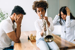 Picture of child making noise by playing trumpet Royalty Free Stock Photography
