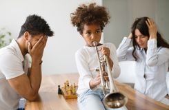 Picture of child making noise by playing trumpet. Picture of cute child making noise by playing trumpet royalty free stock image