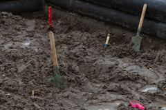 Shovels in the sand royalty free stock photo