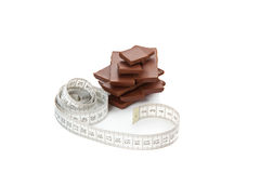 Picture of chocolate  and tape-measure Stock Image