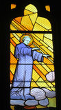 Picture of christian saint on stained glass in the church Stock Photography