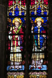 Picture of christian saints on stained glass in the church Stock Photo