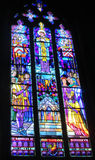 Picture of christian saints on stained glass in the church Stock Photography