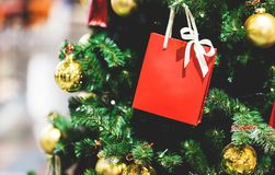 Picture of Christmas tree with gold balls, red packet for gifts. Picture of Christmas tree with gold balls, red packet for gifts in store stock images