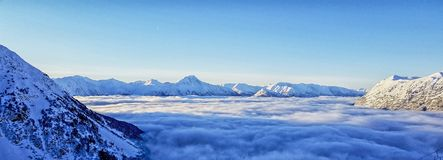 Above the Clouds - Girdwood, Alaska. Picture of the Chugiach Mountains in Girdwood, Alaska. This stunning view can be seen while skiing at the top. On this royalty free stock photography