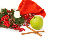 Picture of cinnamon, green apple, santa hat Royalty Free Stock Images