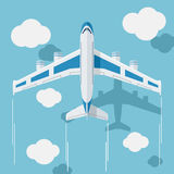 Picture of a civilian plane with clouds. Stock Image