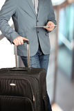Picture of a close up man using a digital tablet with baggage be Royalty Free Stock Images