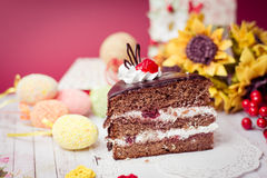 Picture close up on set of cake, colorful eggs and gift decorations Royalty Free Stock Photography
