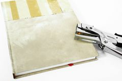 Picture of closed diary with stapler. Isolated on the white background stock photography
