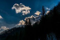 Clouds and a silhouette forest Royalty Free Stock Photos