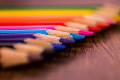 Picture of colored pencils highlighted in blue color. The image shows in a simple way some color pencils with highlight in blue color.n royalty free stock photography