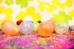 Picture of colorful organic holi color and water balloons for holi fun. Isolated on the colorful background stock photos