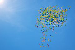 Picture of colorfull baloons in the scky with clouds and sun Stock Photo