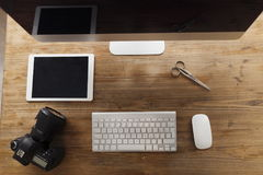 Picture of computer, scissors and camera on working desk. Picture of computer with accessories, scissors and camera on working desk Stock Image