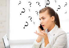 Picture of confused woman with smartphone Royalty Free Stock Photos