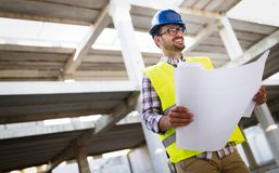 Picture of construction site engineer looking at plan Royalty Free Stock Images