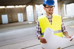 Picture of construction site engineer looking at plan Stock Images