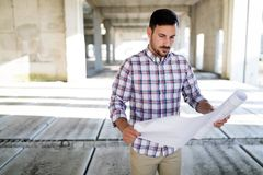 Picture of construction site engineer looking at plan Stock Photography