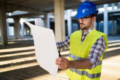 Picture of construction site engineer looking at plan Royalty Free Stock Image