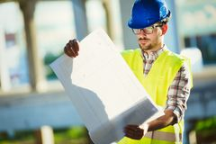 Picture of construction site engineer looking at plan royalty free stock photography