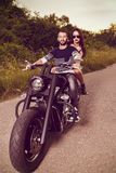 Picture with a couple of beautiful young bikers Royalty Free Stock Image