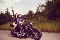 Picture with a couple of beautiful young bikers Royalty Free Stock Photos