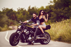 Picture with a couple of beautiful young bikers Royalty Free Stock Photography