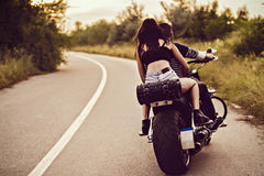 Picture with a couple of beautiful young bikers. Romantic picture with a couple of beautiful young bikers Stock Photos