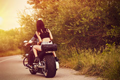 Picture with a couple of beautiful young bikers. Romantic picture with a couple of beautiful young bikers Royalty Free Stock Photos
