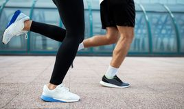 Picture of couple running together in urban area Royalty Free Stock Images
