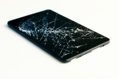 Picture of cracked display on a tablet isolated on white. Tablet with damaged screen.  stock photography