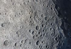 A picture of craters on the surface of the moon.  royalty free stock photos