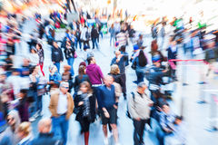 Picture of crowds of people in the city with zoom effect. Picture of crowds of people in the city with intentional zoom effect made by camera royalty free stock image