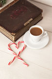 Picture of a cup of coffee, album and candy cane Royalty Free Stock Photography