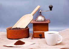 A picture of a cup of coffee, grinder and a coffee filter. Picture of a cup of coffee, grinder and a coffee filter Stock Photo