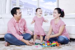 Little girl dances with her parents at home Royalty Free Stock Photography