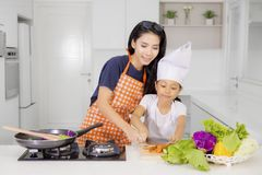 Little girl learns to cook with her mother Royalty Free Stock Images