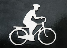 The picture of cycling man. Sign in pedestrian zone. the picture of cycling man Stock Images