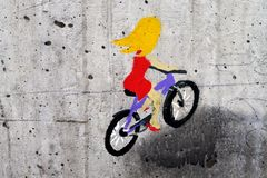 The picture of the cyclist on the concrete royalty free stock image