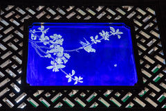 A picture decorated with a window made of glass inside the Chen Clan Academy. Guangzhou city tourist attractions in Guangdong province China Chen Clan Academy stock photos