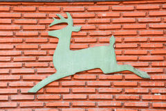 Picture deer on brick wall. Picture deer on the clay brick wall Stock Photo