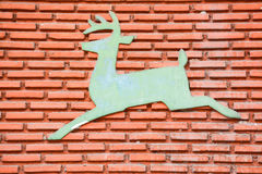 Picture deer on brick wall Royalty Free Stock Photo