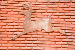 Picture deer on brick wall Royalty Free Stock Images