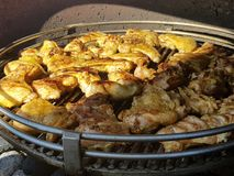 Chicken barbecue. The picture of a delicious chicken barbecue outdoors Royalty Free Stock Images