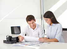 Picture desk in stock photo agency. With images and camera on their desk Royalty Free Stock Image